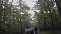 Men Jogging Through Woods Stock Footage