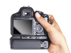 Stock Photo of photo camera in hand