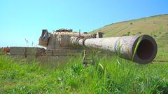 Rusty tank turret with large caliber cannon Stock Photos