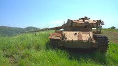 Destroyed rusty tank on battlefield near the border Stock Photos