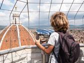 Boy looking through a sightseeing binoculars the dome of basilic Stock Photos