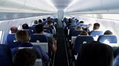 Passengers sitting in airplane. plane. airborne. flight flying. traveling Stock Footage