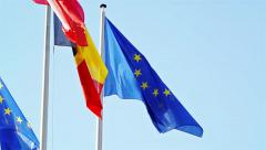Flags of EU, Belgium, Bulgaria waving in front of Parliament, Strasbourg Stock Footage