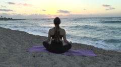 Meditation in the beach - stock footage