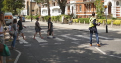 Family have photo on iconic Abbey rd crossing 4K Stock Footage