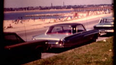 Boston cars park on side of a road next to the beach 1970s vintage film historic Stock Footage