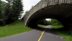 Passing Under Stone Bridge along the Blue Ridge Parkway - stock footage