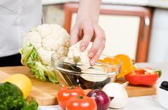 Preparation of vegetarian salad from fresh vegetables Stock Photos