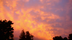 Startling Stormy Sky of Orange, Yellow and Purple Stock Footage