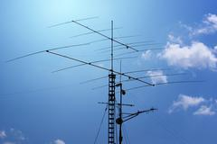 antennas and transmitters on poles - stock photo