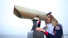 Woman looking through the binoculars. Full HD with motorized slider. 1080p. - stock footage