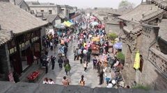 Crowds in the ancient city of pingyao china Stock Footage