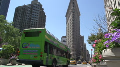 Bus and taxis in front of the Flatiron Building in Manhattan, New York City, USA Stock Footage