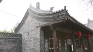 Stock Video Footage of woman sweeps courtyard in the ancient city of pingyao china