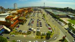 MELAKA - JUNE 2014: Time lapse view of traffic in Melaka's shopping area. - stock footage