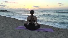 Meditation in the beach sun - stock footage