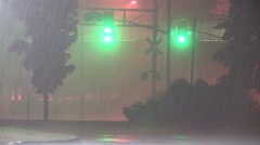 Torrential heavy flooding rain thunder and lightning in severe storm at night. - stock footage