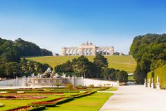 view on gloriette structure and neptune fountain in schonbrunn palace, vienna - stock photo