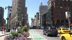 Tilt from taxis to the Flatiron Building in Manhattan, New York City, USA Stock Footage