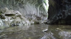 Stream flowing in a wild canyon, Romania Stock Footage