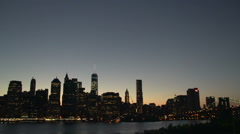 Manhattan New York City skyline at night from Brooklyn heights Stock Footage