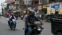 Afternoon rush hour traffic in Tagbilaran City Stock Footage
