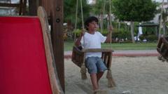 Happy boy swinging Stock Footage