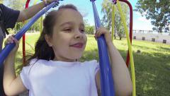 Girl on swing Stock Footage