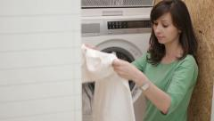 Woman doing laundry Stock Footage