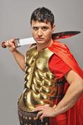 handsome roman legionary soldier - stock photo