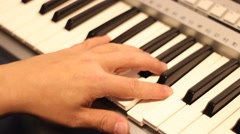 Playing on synth close -up Stock Footage