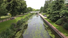 Recreation town park with river and bridge Stock Footage