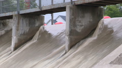 Dangerous fast flowing river water and dam conditions after heavy thunderstorm Stock Footage