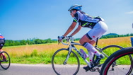 Stock Video Footage of Attractive woman cyclist competing in race in slow motion