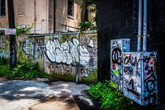 graffiti in an alley in little five points, atlanta, georgia. - stock photo