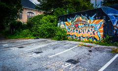 graffiti on a wall and a parking lot in little five points, atlanta, georgia. - stock photo