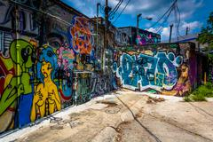 graffiti on walls in an alley in little five points, atlanta, georgia. - stock photo