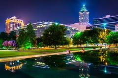 Reflecting pool and buildings at night, at olympic centennial park at night i Stock Photos