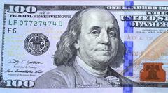 Pan view over 100 dollars new bills Stock Footage