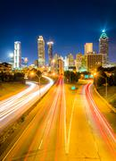 Traffic on freedom parkway and the atlanta skyline at night, seen from the ja Stock Photos