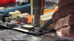 Replacement smd element on pcb plate with  technology soldering hot air HASL. HA Stock Footage