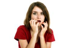 Shocked girl covers her mouth with hands, isolated on white Stock Photos