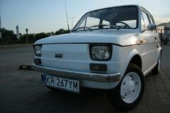 FIAT 126p shot with a little wide angle lens, early evening light Stock Photos