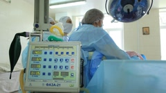 The general surgery: anesthesia device and cardiomonitor on foreground. Stock Footage