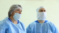 Operation: Two surgeons learn ECG monitor Stock Footage