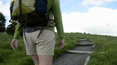 Hiker Turning Corner Uphill Stock Footage