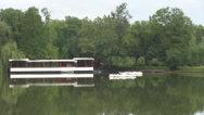 Nice white modern boats anchored on lake near harbor, trees reflection in water Stock Footage