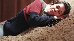 Woman asleep in huge coffee pile Stock Footage