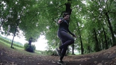 Girl jumping rope in the park Stock Footage
