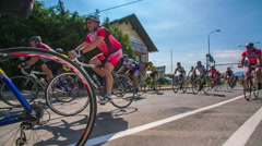 Slow motion shot of a group of bikers racing in marathon Stock Footage